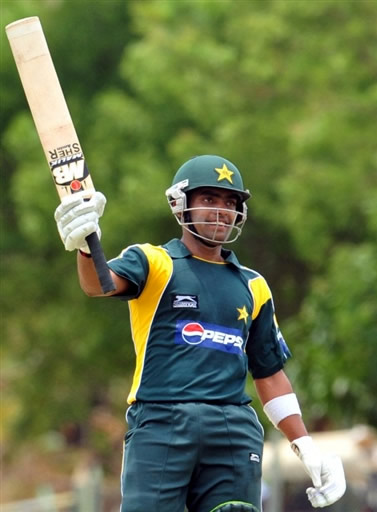 Umar Akmal celebrates his maiden fifty