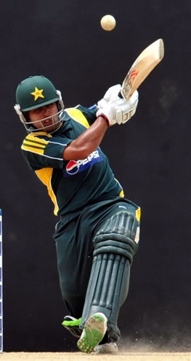 Umar Akmal hits a four