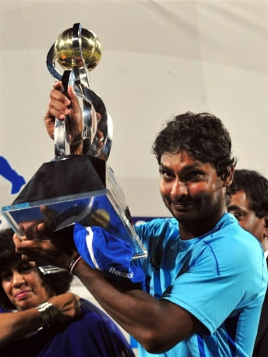 Kumar Sangakkara holds the Trophy