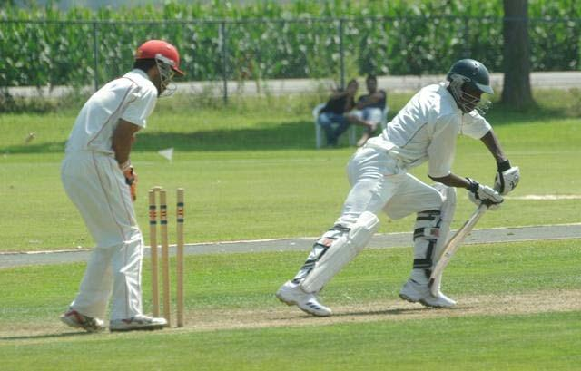 Kenya's Alex Obanda is bowled by Canada's Zameer Zahir
