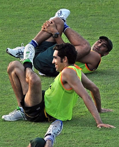Younis Khan & Umar Gul stretch on the ground during training camp