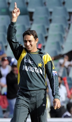 Saeed Ajmal celebrates the wicket of Sammy