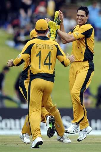 Johnson celebrates the wicket of Afridi