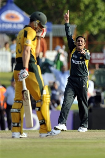 Saeed Ajmal celebrates the wicket of Johnson