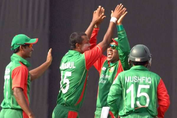 Left-arm spinner Enamul Haque Jr. is congratulated by teammates