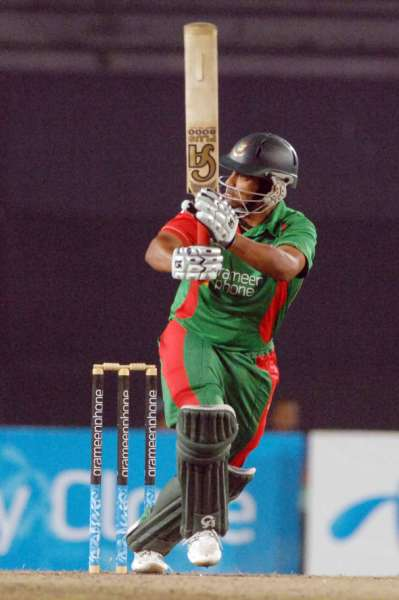 Tamim Iqbal sends one to the mid-wicket boundary during his 80 off 72  balls