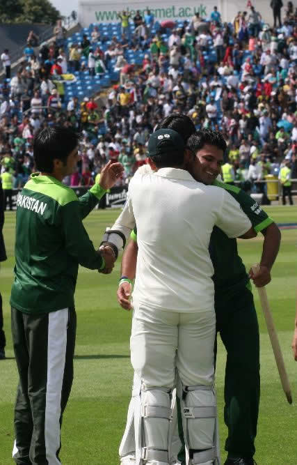 Farhat and Kamran hug each other after historic win over Australia
