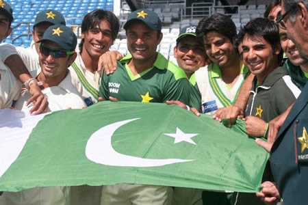 Pakistan team hold Pakistan flag after historic win over Australia