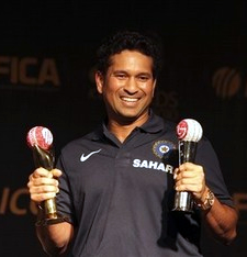 Sachin Tendulkar holds the trophies after he won Cricketer of the Year and People's Choice awards