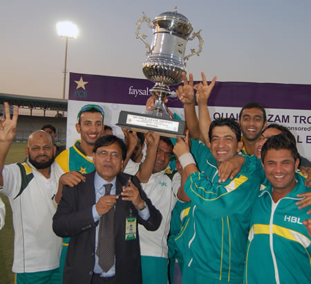 HBL captain Hasan Raza and teammates celebrate with Trophy