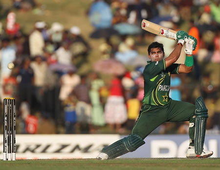 Umar Akmal plays a cover drive