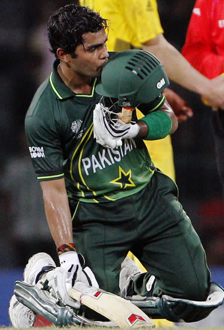 Umar Akmal kisses his helmet after Pakistan's win against Australia