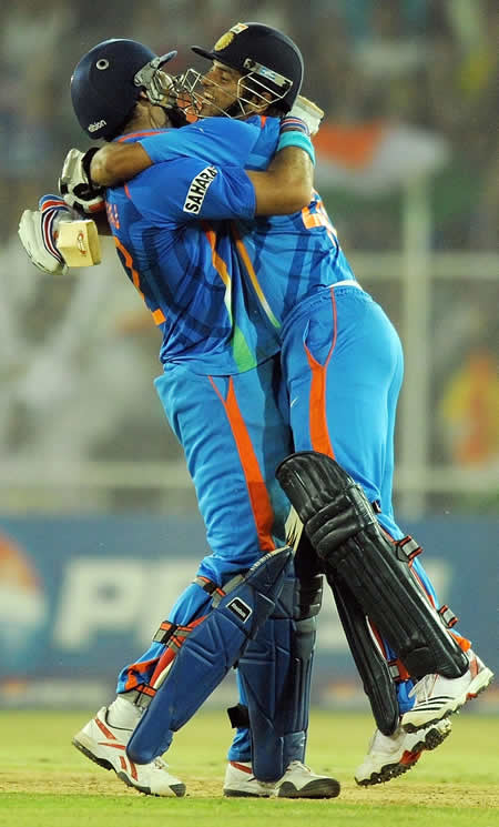 Yuvraj Singh and Suresh Raina celebrate after winning the World Cup Quarter-Final against Australia