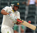 Usman Khawaja pulls during his maiden Test fifty