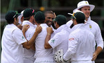 Vernon Philander and the rest celebrate a wicket