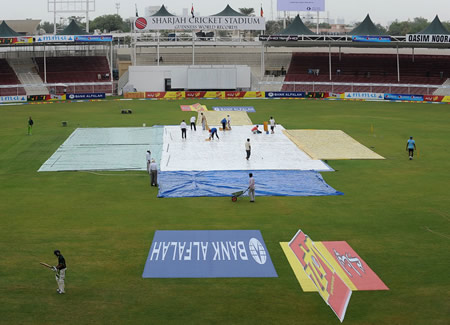 The rare sight of rain delaying play in Sharjah