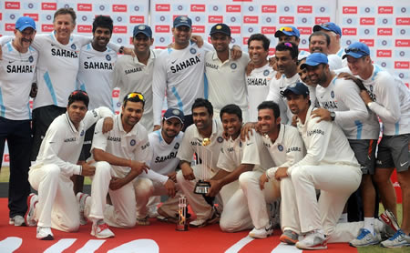 The Indian team and support staff with the trophy