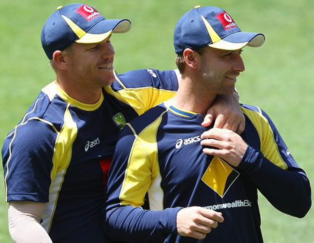 David Warner and Phillip Hughes during a training session at the Gabba