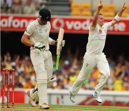 Peter Siddle celebrates having Martin Guptill caught behind