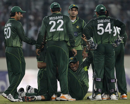 Younis Khan is congratulated on taking a catch