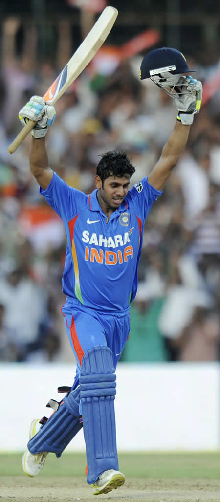 Manoj Tiwary raises his arms after reaching his century
