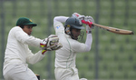 Mushfiqur Rahim chops the ball towards the off side