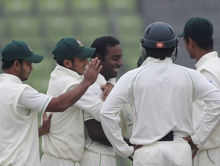 Elias Sunny is congratulated after dismissing Younis Khan