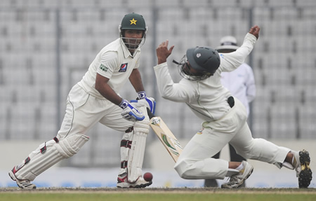 Asad Shafiq watches as Shahriar Nafees attempts to take a catch