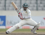 Mushfiqur Rahim pads the ball away