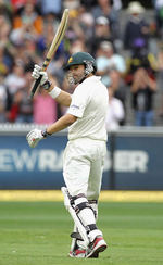 Ed Cowan celebrates getting to a half-century on Test debut