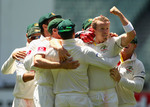 Australia celebrate Peter Siddle's dismissal of Sachin Tendulkar