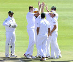 Morne Morkel celebrates with his team-mates after dismissing Lahiru Thirimanne