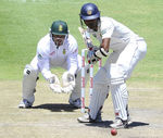 Dinesh Chandimal plays back to Imran Tahir's spin