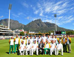 The South African team pose for a photo with the Table Mountain as the backdrop