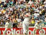 David Warner launches the ball for six