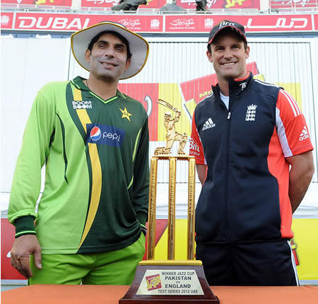 Pakistan captain Misbah-ul-Haq poses with his England counterpart Andrew Strauss with the series trophy
