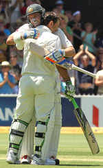 Ricky Ponting gets a hug from Michael Hussey after getting to 200