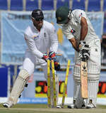 Mohammad Hafeez is squared up by Monty Panesar