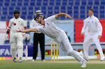 Alastair Cook stretches to hang on to a catch