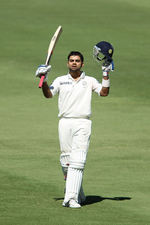 Virat Kohli acknowledges the cheers after his ton