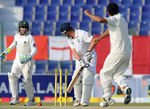 Abdur Rehman turns one past Jonathan Trott's outside edge