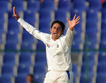 Saeed Ajaml celebrates dismissing Alastair Cook