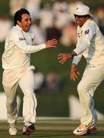 An ecstatic Saeed Ajmal celebrates a strike with Misbah-ul-Haq