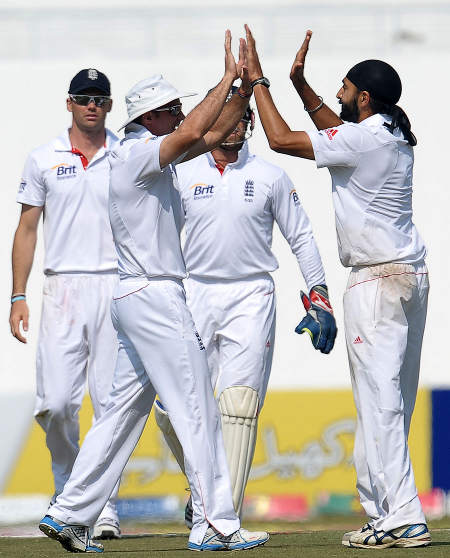 England congratulate Monty Panesar on his 6-for