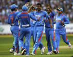 India get together after one of Praveen Kumar's strikes