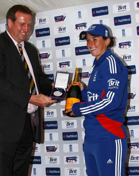 Georgia Elwiss receives the Player of the Series Award from Tim Munton