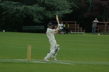 James Reynard (MCC) also goes for a big drive, but edges the ball...