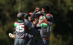 Afghan players celebrating after taking a wicket