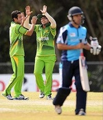 Pakistani players celebrate after taking a wicket