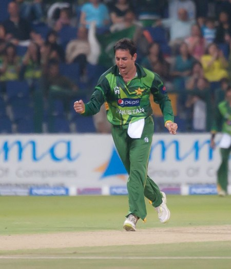 Saeed Ajmal smiles after taking a wicket